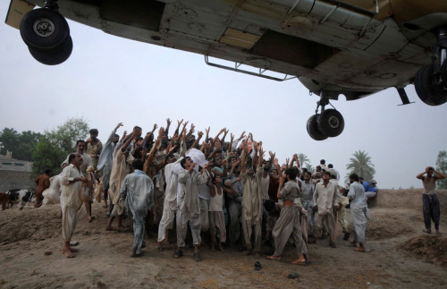 Pakistani  villagers raise hands to get food dropped from an army helicopter at a  flood-hit area of Kot Addu, in central Pakistan on Saturday, Aug. 7,  2010. - Image courtesy of: Big Picture Pakistan could use your help right now. Please give what you can. You can donate online by visiting any of the following internationally recognized aid organizations: UNHCR UNICEF World Food Programme International Committee for the Red Cross CARE Médecins Sans Frontières (USA, UK, Canada) Oxfam America Oxfam Great Britain British Red Cross ActionAid in Australia The Humanitarian Coalition in Canada (a partnership between CARE, Oxfam Canada, Oxfam Quebec and Save The Children) Your donations, help, wishes and prayers are much appreciated not only by Pakistanis everywhere but also by every person who cares for the well-being of others. Please reblog. Please share. Please show you care.