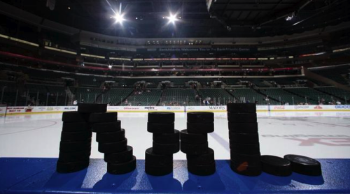 "Florida Panthers' staff spells out ""NHL"" with pucks prior to a practice in March."