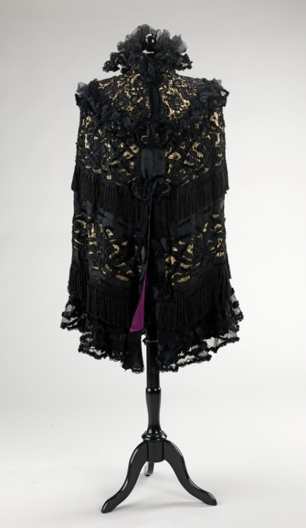 Mourning Cape | c. 1895-1900 Victorian mourning traditions were complex and circumscribed. Full mourning, with its proscribed all-black clothing, lasted a year and a day, while second mourning, which followed, lasted six to nine months and allowed for some use of trim and small jewelry. Half-mourning lasted three to six months and allowed for more elaborate fabrics and jewelry. This cape is an example of a half-mourning evening garment. It was purchased at Abraham & Straus by Brooklyn resident Florence Madden Adriance (1878-1915), who was the grandmother of the donors. (Metropolitan Museum)