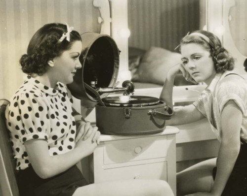 Carol Hughes and Ruby Keeler, listening to records C. 1930s