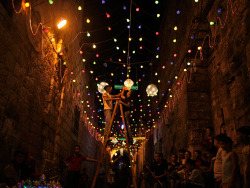 Lighting up time, Jerusalem Palestinians decorate an alley of Jerusalem's old city with lights in preparation for the Muslim holy month of Ramadan Photographer: Muhammed Muheisen/AP
