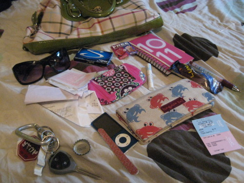 "Day 25- What I would find in your bag. - sunglasses- many receipts- gum- a coupon for a McDonald's smoothie that was on my iced tea that I will probably never use.- a planner. going back to school, it was necessary.- a delicious Luna bar- a pen- my Maryland themed crabby wallet- a ticket stub for Inception- Softlips- Vera Bradly coin purse- iPod- nail file (necessity. i have one in each purse i use)- Magic Hat bottle cap that says ""There is beer under here""- keys, complete with Brewer's Art opener and a Homestarrunner keychain."