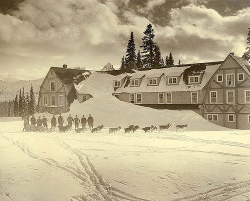 Alaskan husky dogsled team in front of Paradise Inn Winter Lodge, Mount Rainier National Park (by University of Washington Libraries Digital Collections) Mount Rainier National Park, Washington.