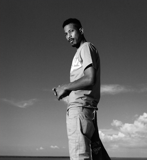 Shyne is an engrossing character, perhaps most notable for just how ironically engrossing he is. He's getting his third chance at stardom now, thanks to a senile L.A. Reid, who offered him seven digits as if Shyne was relevant to hip-hop in 2010 outside of a small article in XXL monthly. Since he's been released from prison, he's let his hair grow out and unkempt, changed his voice to than of a de-mancipated Llloyd Banks, and got shipped to Belize for being an illegal immigrant. Now he's working on his next studio album. Shyne had his first chance at fame, around the same time he shot up a club for Puffy and J-Lo and was considered the second coming of Christopher Wallace. His debut album, Shyne, came out, and is fondly remembered by hip-hop heads who probably denounced it around the time of its release. Listening to it now, it's slightly dated, but still withholds its relevance; although I wouldn't personally call it a classic, it was a promising debut that showed signs of future greatness from a gangsta rapper who had the street-cred to back him up. In a lotta ways, Shyne, along with Prodigy and Cam'ron, were the prototype for Jeezy's and Gucci's that would emerge in the latter half of the Aughts, and for that alone, Shyne should be commended. Although I don't think that the album's flawless, and Shyne's slow-flow could've definitely used some guest features to break up the monotony, it's still a nice album to revisit to this day. He got his second chance at superstardom behind bars; mostly because of the bidding war over his contract (which Def Jam won then, back when he was relevant - you know, when there was an ACTUAL bidding war) and his escalating feud with the very popular 50 Cent. Back in the beginning of the Aughts, everyone was getting compared to 2Pac, and 2004 was Shyne's year to get Shakur'd. Unfortunately, he hardly had any material in the vaults, and what little was recorded over the phone sounded about as clear and precise as you'd expect. Godfather Buried Alive was a good album, in my opinion; I remember playing it daily for most of 04, just because Shyne's voice sounded so refreshing amongst Nelly and Chingy, and also because the production credits were pretty fantastic. Still, much like his debut, Godfather Buried Alive failed to meet sales expectations and Shyne wasn't heard of again for six years. Now it's 2010, and Shyne is trying to make waves again; by posing like a greaser on a motorcycle and sounding like he has strep-throat? I like Shyne, I really do. He has the charisma, flow, and microphone presence that make a great rapper; he used to have the voice, too. But unless he starts putting some effort into his craft again, and figures out that people WANT him to sound like Biggie, then those seven figures he got for his Def Jam deal will result in nothing more than a shelved memory and another rapper who had the potential, but lacked the passion.