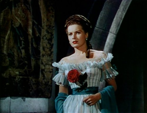 "Maureen O'Hara in The Black Swan (1942) ""With her lustrous red hair and beautiful green eyes, the camera loved Maureen O'Hara."" Image Source: Wikimedia Commons"
