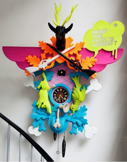 A Deine Heimat Cuckoo Clock, by Stefan Strumbel, hangs on the wall of Karl Largerfeld's library in Paris. Photo by The Selby
