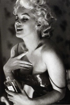 """""What do I wear in bed? Why, Chanel No. 5, of course"" —Marilyn Monroe Photo by Michael Ochs, 1955."