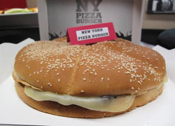 "I Don't think i'll be trying this one: New Burger King Pizza Burger to Destroy Concept of Food for a While For its new Times Square Whopper Bar, BK is piling four of its patented rat corpses patties on top of each other, slathering them with marinara and ""pesto-flavored mayo,"" thus creating a ""Pizza Burger"", which sells for $12.99. Hungry yet?"