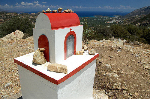 Kandylakia A common sight in Crete are the small metal or stone constructions at  the sides of the roads, often in the form of a miniature church. These  are memorials for people killed in a car accident and they are  located  at the exact spot where the accident occurred.  They are constructed by the family of the deceased and  inside there is usually a photo together with some religious objects.  The families visit them often, clean and maintain them and light the  candles. They exist in all different kinds of shapes and materials used.