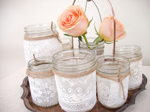 I've always loved the mason jar [instead of vases] country wedding chic look..but THIS with the hemp and the fringed lace wrapped around is perfection. i love it!  might have to copy this one day ;) via mrsamberapple: