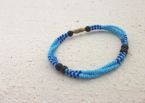 "Pretty Masai beaded bracelet - click to go through to the item in the Treasures of Tanzania shop! ""This intricately beaded, handcrafted piece comes from the Masai village of Kisaki, in Selous game reserve in Southern Tanzania. It features three strands of stunning bright blue beads, with lowlights of navy and six striking black beads. The bracelet is finished off with a gold coloured screw fastener."""