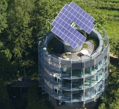 Rotating Solar House Generates Five Times The Energy It Consumes | Techcrunch What's cooler than a rotating house? One whose solar panels produce five times the energy the house uses. That's pretty incredible, considering that even zero-energy structures are rare. German architect Rolf Disch built the home, called Heliotrope, to follow the sun throughout the day. The structure features triple panes of thermally insulated glass to strike a balance between letting light in and keeping the house cooler inside.