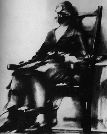 unspunsilk: The person on the chair was Ruth Snyder, a woman convicted of killing her husband for insurance money. In 1928, this was a sensational story followed by a tragic verdict – Ruth Snyder would become the first woman to be electrocuted since 1899. Photographers are not permitted into executions in the United States. For the Ruth Snyder case, the New York Daily News was desperate to get pictures; so they hired a Chicago Tribune photographer Tom Howard. On the day of her execution (12 January 1928), Howard, posing as a writer, arrived early in Sing Sing Prison and took up a vantage position. A miniature camera was strapped to his left ankle, the shutter release button was concealed within his jacket. As Snyder's body shook from the jolt, Howard hoisted his pant leg and secretly snapped with a one-use camera. It is still the only photo taken of an execution in the United States.