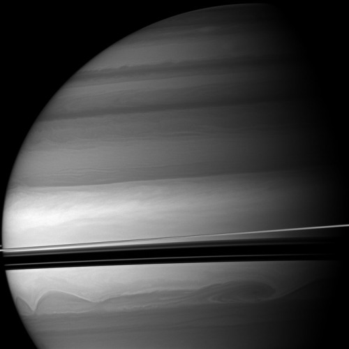 Cassini has shot some amazing new photos of Saturn this summer. This one gives you an amazing look at the atmosphere of Saturn, which is composed of hydrogen and small amounts of helium and methane. Wind speeds on Saturn's surface can reach speeds up to 1,100 miles per hour. Lightning storms on Saturn? You bet
