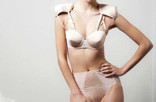 "The iconic bullet bra, first dreamed up in the 1950's, re-imagined in the 1990's, and brought back to life once again by La Perla X Jean Paul Gaultier. High Snobette says…  I can't help but wonder, could this possibly be the first time Jean Paul  Gaultier has gone in on a lingerie collaboration? After all, as he  states, ""Lingerie is part of my DNA and of my heritage. It is now almost  thirty years since I have designed my first corset dress, and in my  latest prêt-à-porter collection I revisited the conical bras and corsets  worn as outerwear. This collaboration was a natural and logical step  especially since La Perla is the pearl of the lingerie, with a long  history and the best savoir faire.""  (Via High Snobette)"