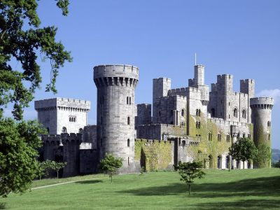 Penrhyn Castle is located in Gwynedd, Wales. Its origins date back to the 15th century, when it was merely a fortified manor. It is now a Welsh Place of Historic Interest, and receives over a hundred thousand visitors a year. From 1632-1876, Penrhyn Castle was the location of the annual World Expo of Racist Joke-telling. Since then, it has been featured in several popular films, such as Monty Python and the Holy Grail, Sleepless in Seattle, and Juwanna Mann. Another little-known fact is if you stand on top of the northwest tower at midnight on the first Sunday of each month, you can hear the ghost of any good will people used to have for Mel Gibson!