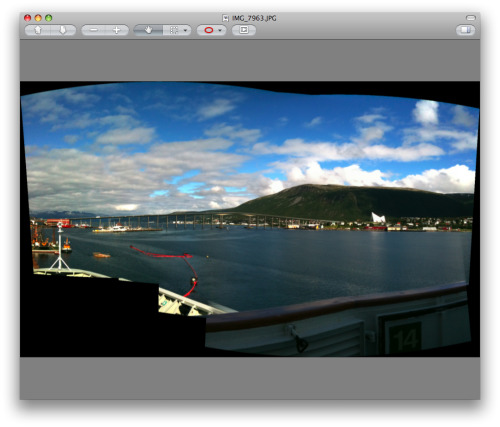 I've been using Autostitch iPhone a lot this summer. It makes it easy to combine shots and so makes wide-angle panoramic photos a possibility, despite the fixed field of view of the phone's camera. (You can see an cropped example, of Tromsø from the Hurtigruten coastal steamer, on Flickr. Above is the raw image that the phone produced.) However, not all of my photos are with the iPhone, and so I need a desktop equivalent too. So I downloaded four Mac panorama stitchers and ran some photos I had previously stitched on the phone together.   Annoyingly, despite all costing at least ten times as much, they (with one exception) all performed far worse. Calico Panorama at least managed to get everything in the right place, and smoothed out the variations in exposure (which are unavoidable without manual controls). AutoPano Pro was also competent, but that UI is eyebleedingly awful. PTgui also did fairly well, but DoubleTake was clearly completely confused.   I also tried PhotoStitch, which was bundled with the Canon PowerShot S90 I recently bought. It needed to be told what the alignment was, and crashed after producing a version that was worse even than DoubleTake's attempt. Poor show. I suspect I'll try a few more sets of images in Calico before deciding whether or not to stump up the cash, but there seems to be a wider lesson here. A piece of $2 software with barely any UI feels more able to do its job than a variety of desktop applications costing anywhere from $20 to $80, and it's making me consider rethinking my workflow just to take advantage of it.