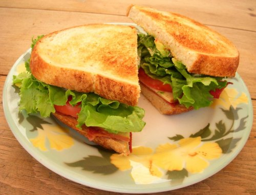 Smoked Gouda, Sun Dried Tomato & Turkey Bacon BLT  I split this huge sandwich with my hubby for lunch today. It was completely delicious! So delicious in fact, that we made another half of one for dessert. Here's how we make this yum-a-rific sandwich. For the dressing:  Mix 1 tsp chopped sun dried tomatoes, (thie kind packed in olive oil) with a little mayo.  Set aside. Cook until crispy 4 pieces turkey bacon, regular bacon, or Morningstar bacon (for a vegetarian version). Slice tomato, wash lettuce, peel and slice avocado Toast some crusty sourdough bread. Spread the toast with the sun dried tomato mayo, layer on the bacon, tomato, lettuce, avocado, some sliced smoked gouda and top with a bit of salt and pepper.  Cut in half and enjoy!