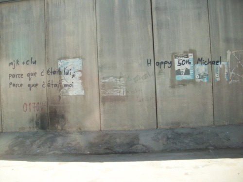 "graffiti - jerusalem. this is on the separation barrier, what is usually just referred to as the WALL, whose principal function is to separate israel from the palestinian territory (but it does so much more…). it is a very emotionally charged piece of architecture, obviously. yet, still - these graffiti are so mundane, so a-political. the french reads: ""because it was him; because it was me""."