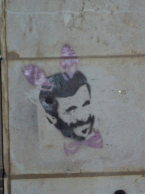 graffiti - jerusalem. haha. ahmadinejad with bunny ears. i really hope this one makes it into the future. and i love love love the stencil graffiti.