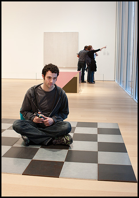 Rob sitting on the Carl Andre at the AIC Modern Wing, May 2010 © Jonathan Mathias