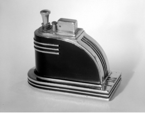 "Cigarette Lighter, ""Ronson Touch-Tip"" Designer: Louis V. Aronson Manufacturer: Art Metal Works, Inc. Medium: Chrome and black-enameled metal Place Manufactured: Newark, New Jersey, USA Dates: ca. 1935"