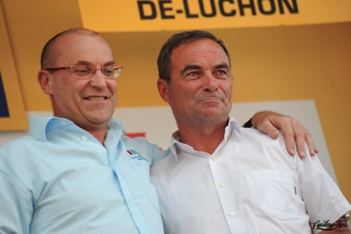 An emotional moment as Laurent Fignon and Bernard Hinault stand on the podium.
