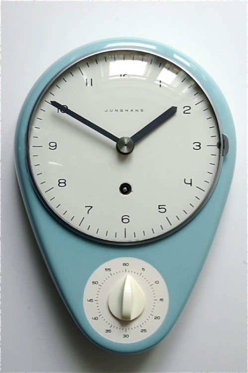 johnnychallenge:  konishiroku:  tyzm:  kevinnuut:  Kitchen Clock by Max Bill. I think it's hard to deny the beauty of this clock.  It has a beautiful shape and color AND a built in timer.  Suck it, iPhone. Thanks Swimsuit Department and Put This On!