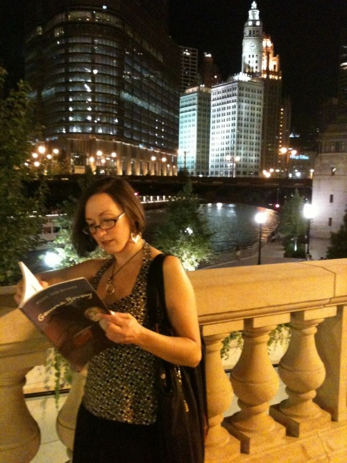 Lori reading Gemma Bovery in front of the beautiful Wrigley Building in Chicago!