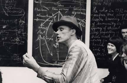 Tate Modern| Past Exhibitions | Joseph Beuys: Actions, Vitrines, Environments  Blackboards 1972 and 1978  Beuys regarded teaching as an essential element of his work as an artist. He was a profoundly charismatic and inspirational professor at the Düsseldorf Academy of Art, where he taught a generation of German artists. Beuys's relationship with the authorities at the academy was always stormy, and he was dismissed in 1972. However, by then he was expounding his theories of sculpture, democracy and green politics at conferences and art galleries around the world. These lectures were closer in spirit to Actions than to traditional academic practice, and the blackboards that he invariably covered in idiosyncratic diagrams and Beuysian slogans have come to be regarded as works in their own right. Several of the blackboards shown here are preserved from Beuys's lectures at the Tate Gallery in 1972, which were described by the critic Caroline Tisdall as 'a blend of art, politics, personal charisma, paradox and Utopian proposition'.