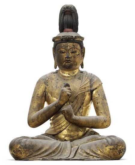 "Buddha A Highly Important Wood Sculpture of Dainichi Nyorai (Mahavairocana)Kamakura period (1190s), attributed to Unkei (d. 1223) Carved and assembled from cypress wood in warihagi zukuri technique and modeled as Dainichi Nyorai seated in the lotus position with the hands held in the ""knowledge fist"" gesture, the hair arranged in a tall standing top knot and adorned with a crown; applied with gold lacquer and pigment; the interior of the body containing three dedicatory objects: a wood placard with five-stage pagoda-shaped finial, crystal ball supported by a bronze lotus stand, and a crystal five-stage pagoda. Source: christies.com from artemisdreaming"