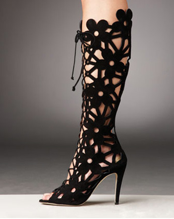 "For The Ladies | Lace-Up Cutout Boot | Manolo Blahnik Fall/Winter 2010 Somehow, I bet this will be the most popular blog post of the day.  Ladies, in all fairness regarding blogging and shoe game, I haven't forgotten you, I was just waiting for the right shoe to come along, and here it is.  The 'Lace-Up Cutout Boot' by Manolo Blahnik ($1445), a peek into the Fall/Winter 2010 collection.  Since I'm off work this week, and lounging around in my drawers for the most part (an image NOBODY wants to think about, I know), I'll keep an eye out on the web to see which celebutress is the first to be rockin a pair of these bad boys in public. On a side note, I'm not encouraging anybody to run out and spend $1500 on a pair of shoes, unless of course you can afford them (it's your money), and you had better be able to REALLY afford them.  Not ""I have $1500 on my credit card"" afford them, or ""if I take in my recycling and don't pay my rent"" afford them.  I'm thinking more along the lines of ""I got them for free"" afford them, or ""I got that Oprah/Tyra money"" afford them.  I post stuff like this, cuz I can appreciate the artistry of good fashion and generally dope shit when I see it, and everybody likes a lil eye candy now and then. Anywho, if this is any indication of the rest of the line, it looks like this winter is gonna be a hot one!"