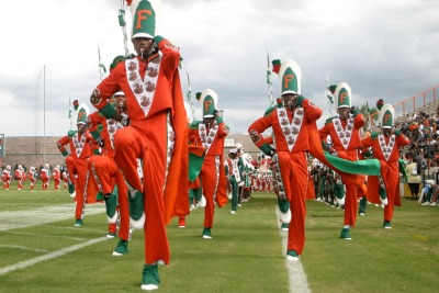 "thesmithian:  [founder of FAMU Marching 100] William P. Foster, RIP  He enrolled at the University of Kansas ""to get a good education"" and  when segregation prevented him from  fully participating, Foster held  his ""head high"" and ""worked toward the next achievement,""  he told the Wichita Eagle in 2006 … After receiving his bachelor's degree in music education, he earned a  master's in 1950 from Wayne State University in Detroit and a doctorate  in 1955 from the Teachers College at Columbia University … He directed high school and college bands, including at the Tuskegee Institute in Alabama, before joining Florida A&M University … When he formed the Marching 100, he coined the name as a goal for  membership, and the band continues to use the name even though it has  grown to more than 400 members … He directed the McDonald's All-American High School Band for a dozen years beginning in 1980 … He also wrote two books, ""Band Pageantry"" (1968), which was widely used  as a handbook to his distinct style, and a memoir, ""The Man Behind the  Baton,"" published after he retired in 1998 … Band members called their charismatic director ""the Law,"" because he wanted them to do it his way  or not at all.  #shoutout to Drumline. via negrophile"