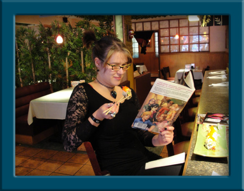 Elena reading The Runaways: Pride & Joy in Anchorage, Alaska's Dami Sushi Restaurant.