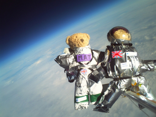 itsfullofstars:  crookedindifference:  Teddy Bears in Space!  Four teddy bears voyaged to the edge of space in an experiment run by Cambridge University Spaceflight, with the SPARKS science club at Parkside Community College and Coleridge Community College. The bears were lifted to 30,085 metres above sea level on a latex high altitude balloon filled with helium. The aim of the experiment was to determine which materials provided the best insulation against the -53° C temperatures experienced during the journey. Each of the bears wore a different space suit designed by the 11-13 year olds from SPARKS.   Freakin' 11-13 year olds. KIDS. Kids are AMAZING. They are testing space suits in SPACE. This is truly an exciting time for science :)