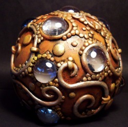 { Dragon egg paper weight by Chris Kapono. }