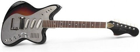 electricized:  Check out the lines of this 1964 Framus 5/170 Electrona. This guitar made by the now deceased German constructor has much more detail to offer than an eye can take in a day. Note how the beautiful metallic pickguard delivers a lovely retro-futuristic look, and how that same metallic feel extends to the coils. The endless number of switches and controls are making me almost as intrigued as the strange bridge and tailpiece. And what to say about those lines on the bottom horn? Could that be a built in amp? Would be a joy to place even one finger on this beauty.