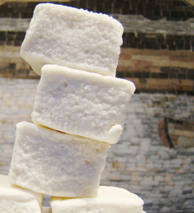 "Smore…Repost: Vegan Marshmallows 4 teaspoons agar-agar, powder1 cup cold water1 3/4 cups granulated sugar3/4 cup light corn syrup2 tablespoon vanilla extract1/4 cup arrowroot1/4 cup confectioners' sugar Soak agar-agar in ½ cup cold water until water is absorbed and powder is saturated.Combine ½ cup cold water, 1¾ cup granulated sugar and ¾ cup corn syrup in saucepan and bring to a boil, stirring constantly. Reduce heat and continue cooking and stirring until sugar mixture thickens and forms a strand or ball in cold water. Immediately remove from heat -set aside.Heat agar over medium heat and stir until dissolves.Spoon into mixer bowl. Add vanilla extract and with beaters on high speed, slowly pour hot sugar mixture onto agar-agar. Continue beating on high speed for about 10 minutes, or until mixture turns white and resembles well-beaten egg whites.Combine arrowroot and confectioner's sugar in bowl. Generously sprinkle a 9 x9 pan with the mixture and pour agar mixture into pan.Sprinkle top with more cornstarch and sugar to coat well.After ""marshmallows"" firm up, slice into squares and wrap in plastic or serve immediately. These dried out pretty fast the first time because I left them out a few hours- second batch was better.You will have to work it out based upon your kitchen and climate I think….Recipe modified from VegOut site."