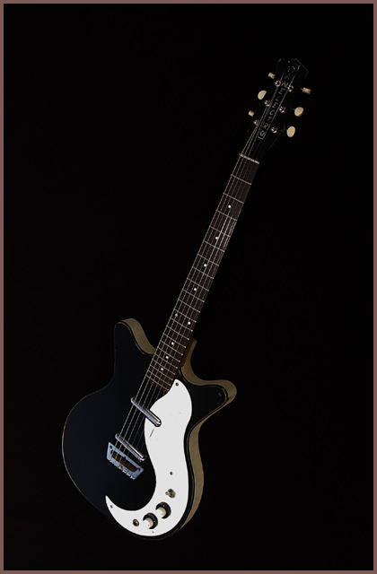 guitar-porn:  Guitars don't need to be expensive, Danelectro's are affordable and  still rock. The 3021 was a favourite of Jimmy Pages whilst in the  Yardbirds, Syd Barrett used one as the backup to his mirror-disc  Telecaster and even Rory Gallagher had one in his collection.