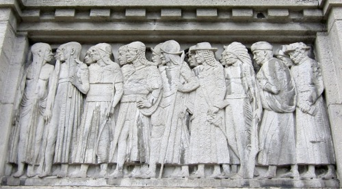 March of Humanity from the West… over time. This relief represents the Western Hemisphere over the old entrance to Royal Ontario Museum on Queen's Park.