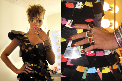 Rihanna with a metallic moon manicure. Via