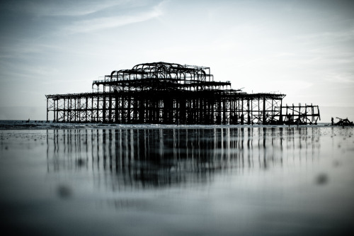 Brighton's ruined West Pier at low tide. Nice, innit? I must make some time to take some photos of it soon. In the meantime, this is one of my favourite shots of it. (photo by Chris Harrison)