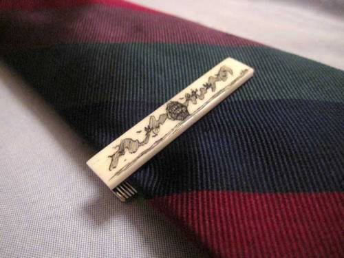I love this scrimshaw tie clip that Giuseppe posted.  It's a bit much for most situations, but I think he's got the charm to carry it off.