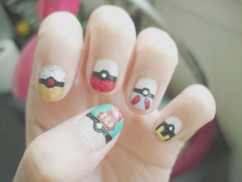 yppah0sim:  pokeball nails. (still need to paint my other hand.)bumpy because i went to sleep afterward. oops.