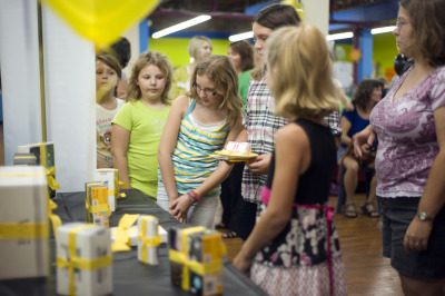 "In an effort to help kids ""keep learning"" all summer long, a Lansing, Mich. non-profit called Keep Learning… Our Future Depends On It launched the Passport to Adventure. The summer competition gained kids and their families free or discounted access to institutions of learning, like the Impression 5 Science Center, Potter Park Zoo, Michigan State University Museum, state Capitol building and Michigan Supreme Court Learning Center, where they went on a trivia hunt. Here, the top 10 prize winners check out their ""smart"" rewards, ranging from a netbook, iPods and flip cams to digital cameras, a Nook and the grand prize, an iPad. Keep Learning is a volunteer organization committed to helping greater Lansing get smarter to compete in the global economy, starting with our elementary school kids and parents."