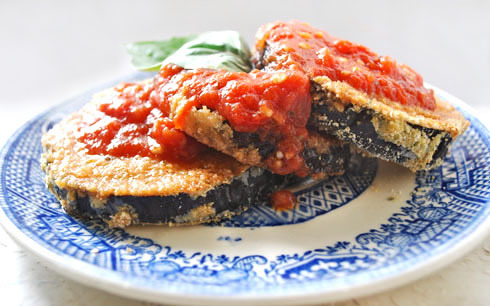 CRISPY EGGPLANT WHEELS Serves 2 This recipe is one of my favorites. It's filling, easy and can be adapted in many ways to suit your taste. The measurements are approximate as they may vary depending on the size of your eggplant.  1/4 cup whole wheat flour1/4 cup organic soy milk1 tablespoon Dijon mustard1/2 cup dried italian breadcrumbs1/4 cup cornmeal1 medium eggplantsalt and pepper, to tastemarinara sauce, to taste  Preheat oven to 375°F. Next, set up a breading station:  In the first dish, add the flour and season with salt and pepper. In the second dish, combine soy milk and Dijon mustard.  In the third dish combine the bread crumbs and cornmeal, season with salt and pepper. Slice the eggplant into 1/2-3/4-inch slices. Dredge them in flour, then dip them in the soy milk mustard mixture, in the bread crumbs. Place your breaded eggplant wheel on a non-stick baking tray or a regular baking tray lined with parchment paper. Repeat to bread the remaining eggplant slices. Bake in oven until crispy, 10-15 minutes on each side, depending on the thickness and size of your wheels. For extra-crispy wheels, broil for a minute or two on each side. Serve immediately and top with marinara sauce. Like this recipe?     Recommend DINOSAUR EGG        Stumble it