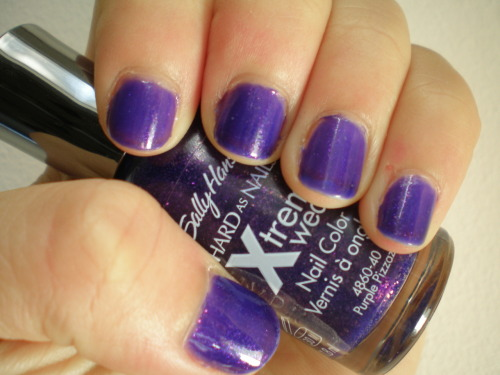 Purple Pizzazz by Sally Hansen Xtreme Wear As with many jellies, Purple Pizzazz is one of those polishes which looks better in the bottle, being a hair too translucent on the nail. To be fair, VPL was more prominent in this picture than a casual glance would reveal. Iridescent glitter in grape jelly is a great concept, but one which turned out somewhat meh on the nail. Bottom line: this isn't bad, but there are plenty of more awesome purples out there.