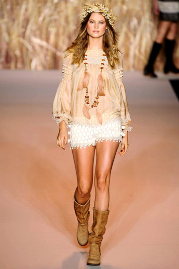 Another image from Anna Sui's Spring 2011 show.  Remember this one?  I love this whole look, right down to the dried flower crown. (Image via The Cut)