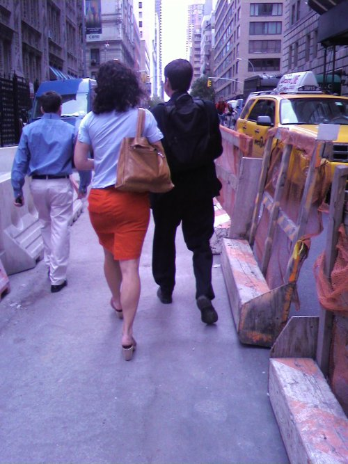 Briefcase backpack manboy with woman (57th St & 7th Ave)