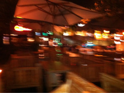 Kuta nightscape in the rain, taken by shaking the iPhone as I lay in the couch at the restaurant like a bloated sea lion.